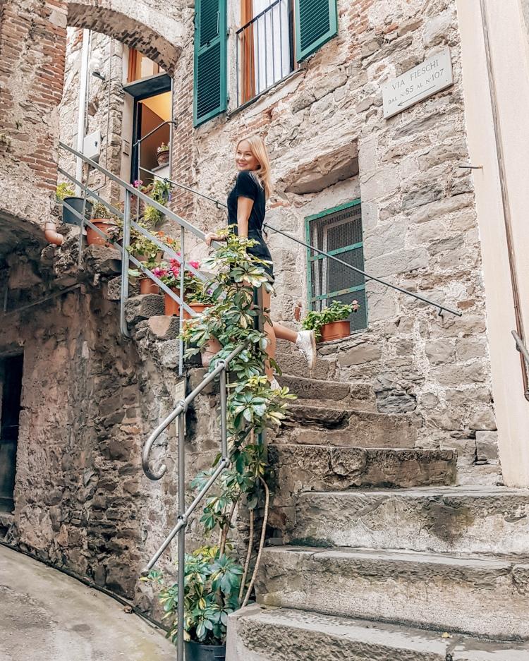Posing on the beautiful steps in Corniglia, Cinque Terre, Italy
