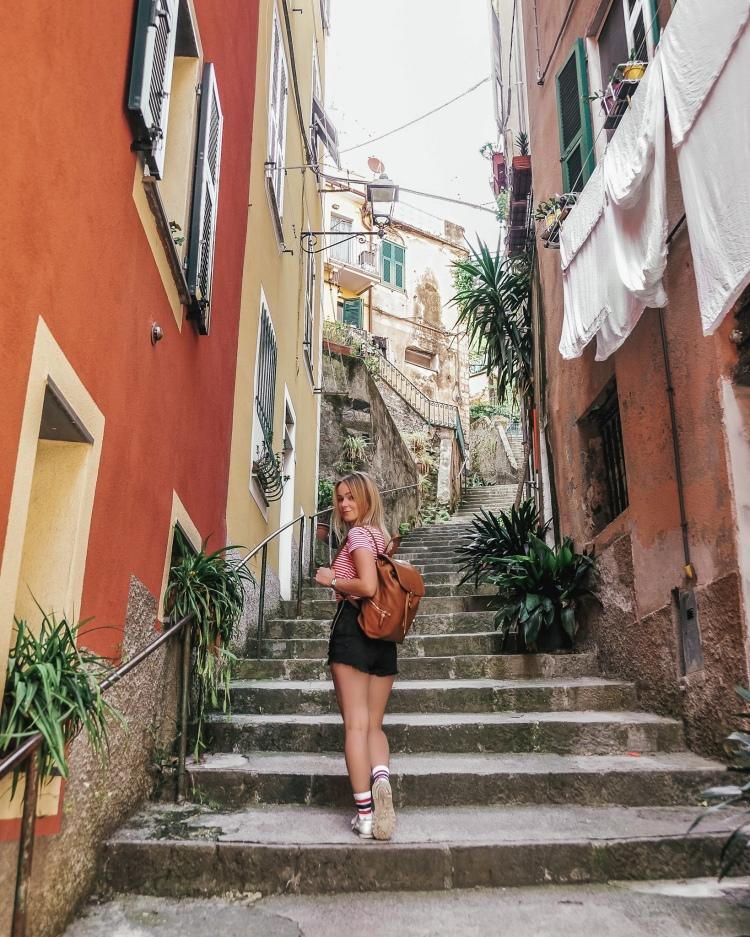 Walking a narrow street in Monterosso al Mare, Cinque Terre, Italy