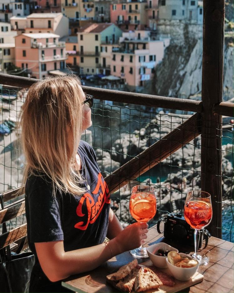 Having Aperol Spritz in Nessun Dorma, Cinque Terre, Italy
